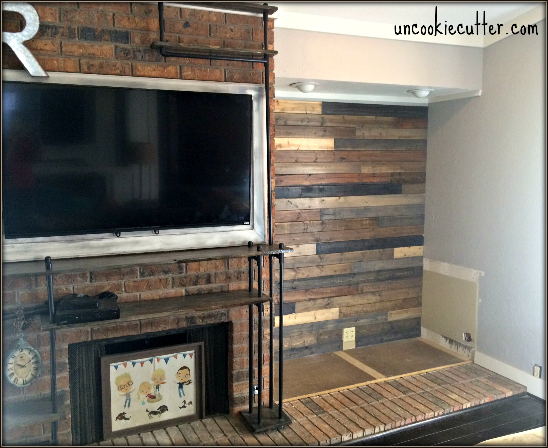 i created this mixed wood wall with cheap wood paneling from lowes leftover stain and