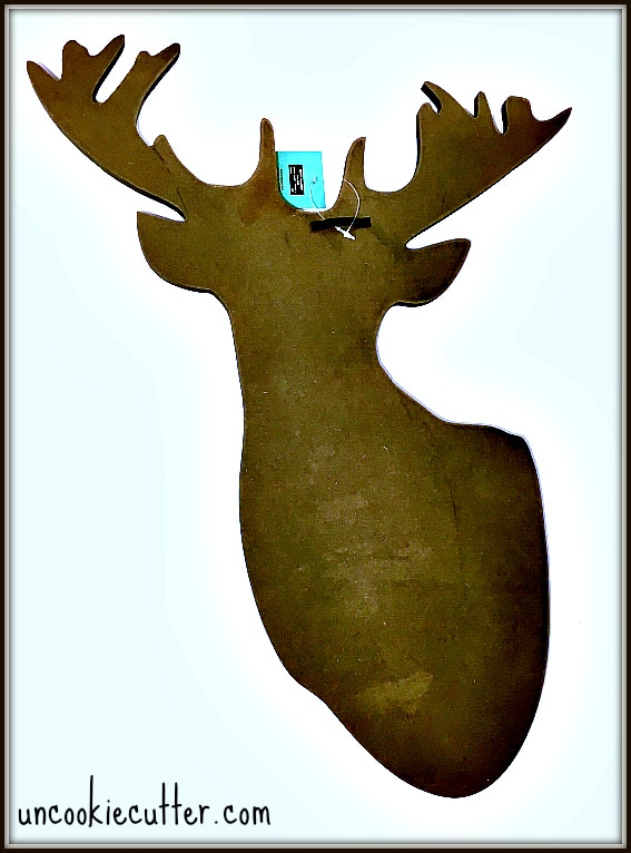This reindeer door hanger is a super quick and easy project that is the perfect compliment to my rustic Christmas porch. Get all the details at UncookieCutter.com!