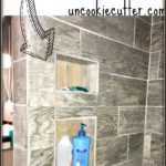 How to build a DIY shower nook with recessed shelves perfect for shampoos and accessories.